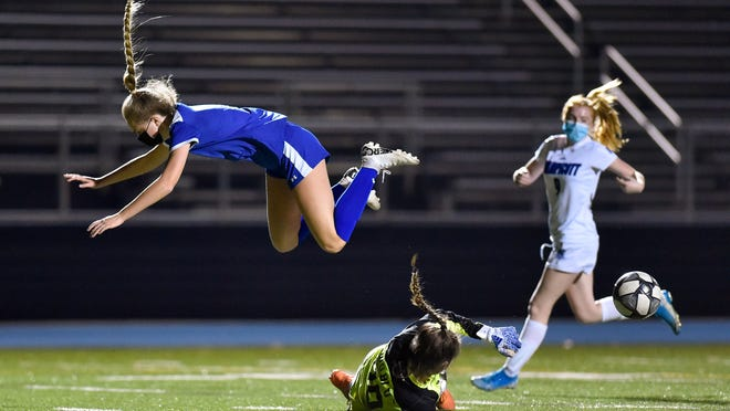 Reese Pszenny of Danvers flies through the air after getting tripped up by the Swampscott goalkeeper during a game at Danvers High School on Friday, Nov. 6.