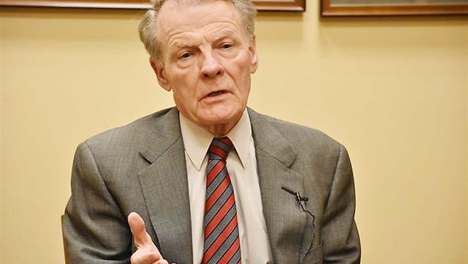 House Speaker Michael Madigan, a Chicago Democrat, is pictured speaking to graduate students in the University of Illinois Springfield's Public Affairs Reporting program last year at the Statehouse. Two more members of Madigan's House Democratic caucus have called on him to resign this week.