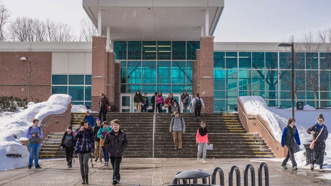 Lakeview High School students head home on Thursday. The school's discipline statistics continue to show racial inequities, but leaders of the effort to solve the problem say they're undaunted by the lack of immediate success.
