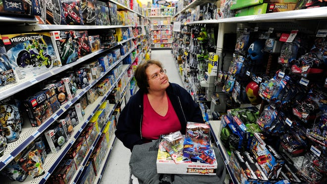 Angel Swin shops for her children's Christmas gifts at the Super Kmart on Bridge Street in this file photo from November 2012.