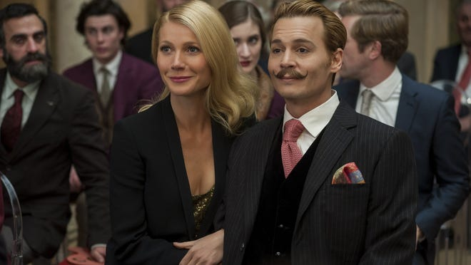 "Gwyneth Paltrow and Johnny Depp in ""Mortdecai."""