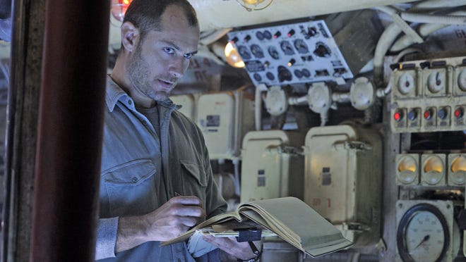 "Jude Law stars as Robinson, a rogue submarine captain after sunken treasure, in ""Black Sea."""