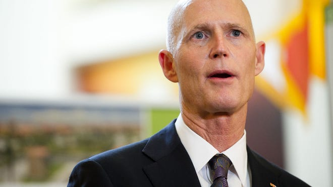 Florida Gov. Rick Scott highlights his proposed cell phone and TV tax cut as part of his 2015-2016 during a press conference at the Bonita Springs Chamber in Bonita Springs, Wednesday, February 4, 2015. (Logan Newell/Special to the News-Press)