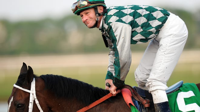 Kentucky Derby winning jockey Calvin Borel shoots a smile to his fans after finishing in fourth place in the First Running of the $75,000 James Whitcomb Riley Stakes race at Indiana Downs on Wednesday, May 12, 2010. (Matt Detrich / The Star)