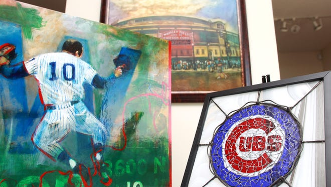 Chicago Cubs-themed art, from left, by Jeff McNutt, John Hanley and Chelle Lehman is seen Monday at McNutt Gallery.