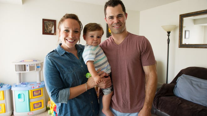 Laurie and Greg Schwind, whose son, Grady, is 14 months old, spent six years living in Boston. They've returned to the area in hopes of buying a home and settling down on suburban Rochester's west side.