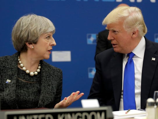 U.S. President Donald Trump, right, speaks to British