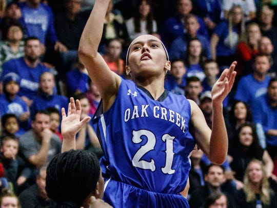 Oak Creek senior Kassandra Bartek (21) elevates for a shot during the WIAA Division 1 sectional final against Rufus King at West Allis Central on Saturday, March 3, 2018.