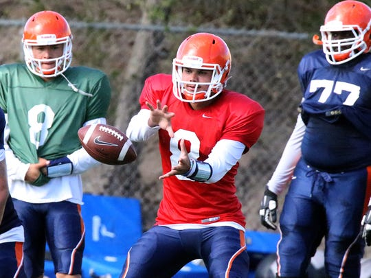 UTEP quarterback Zach Greenlee, 8, takes the snap during Tuesday's practice at Glory Field. Greenlee, a junior transfer from Fresno State, won the starting spot on the team.