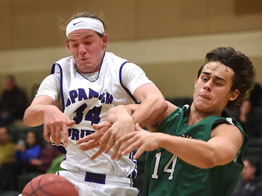 Spanish Springs' Korbin Marcum, left, and Saint Marys' Jordan Trotter battle for a rebound in the first half of Thursday's game at Wild West Shootout at Bishop Manogue.