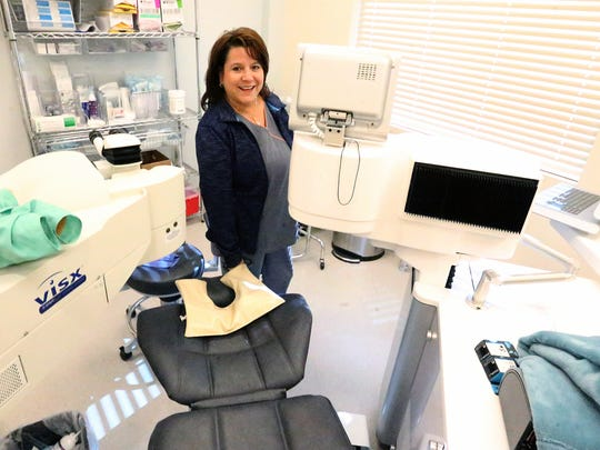 Cindy Avila, Opthalmic technician, inside the laser suite at Sun Laser Vision, 5920 Cromo Drive.