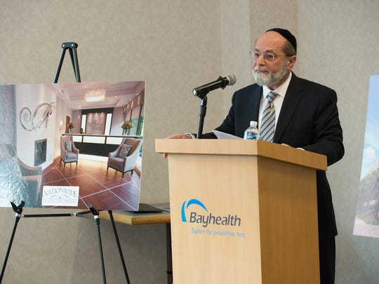 Meir Gelley, President & CEO of Nationwide Healthcare Services, speaks during a press conference regarding the purchase of the Milford Memorial Hospital property.