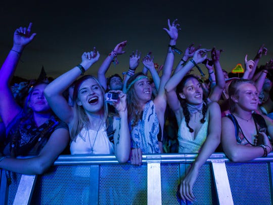 Fans cheer as M83 performs at the Firefly Music Festival