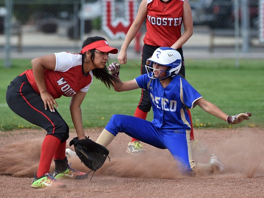 Reed's Trinity Cossette gets to second base before the ball reaches Wooster shortstop Laticia Molina during Thursday's game at Wooster.