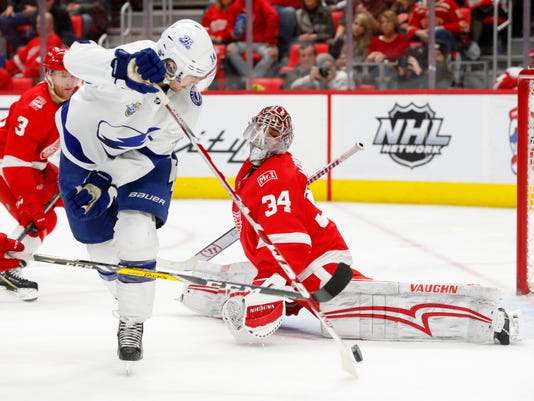 Detroit Red Wings goaltender Petr Mrazek (34) stops a Tampa Bay Lightning left wing Chris Kunitz (14) shot in the third period of an NHL hockey game Sunday, Jan. 7, 2018, in Detroit. (AP Photo/Paul Sancya)