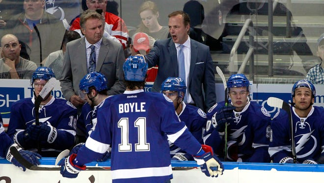 Tampa Bay Lightning head coach Jon Cooper talks with Tampa Bay Lightning center Brian Boyle against the Detroit Red Wings during the first period in Game 1 of the first round of the the 2015 Stanley Cup Playoffs at Amalie Arena. Cooper is not changing his team's game plan despite the opening loss.