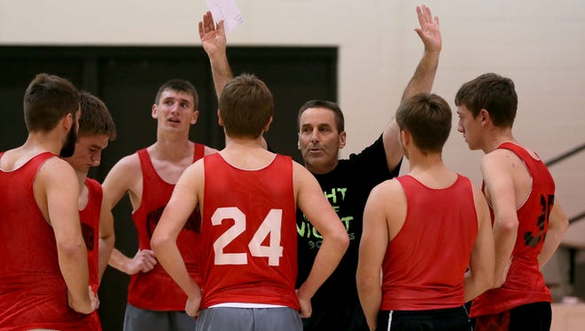 Harlan's Mitch Osborn has been named national high school boys' basketball coach of the year.