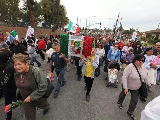 The mile-long annual Our Lady of Guadalupe Procession includes colorful floats, equestrian groups, mariachis, indigenous dancers and Catholic school students escorting the official archdiocesan pilgrim image of the Virgin of Guadalupe.