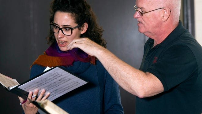 """Pensacola Opera Executive Director, Jerry Shannon, right, works with Soprano, Evelyn Saavedra, for upcoming production of """"Dead Man Walking.""""  The March performance will be a first in Florida for production, said Shannon."""
