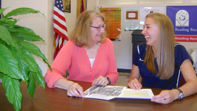 Board of education member Sheryl Weber and Kjersten McKinniss, a 2013 Mansfield Senior High graduate, talk about McKinniss' upcoming trip to Scotland to participate in the world's largest performing arts festival.