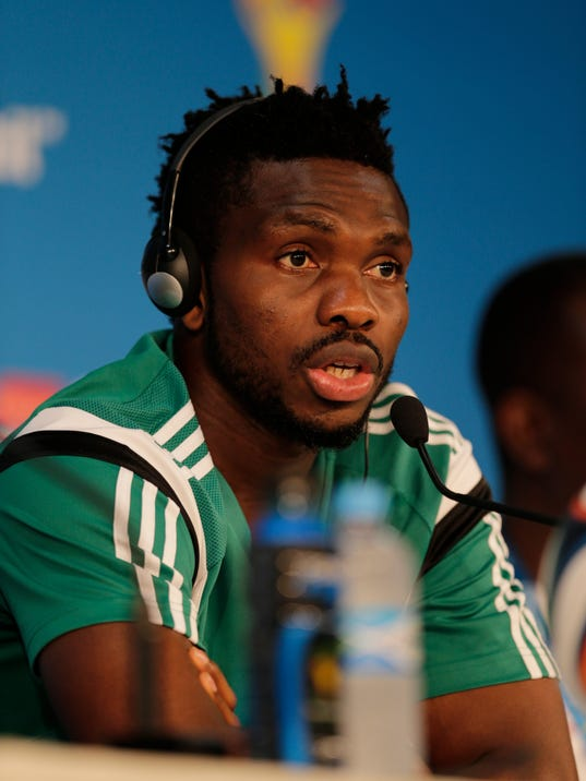 Nigeria's Joseph Yobo speaks during a news conference prior to a training session at the Arena Pantanal in Cuiaba, Brazil, Friday, June 20, 2014. Nigeria plays in group F of the 2014 soccer World Cup. (AP Photo/Fernando Llano)