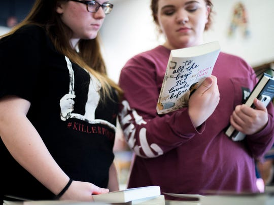 Millville students Ariana Probst, 16, left, and Courtney