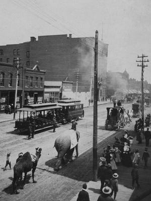 A circus camel and an elephant take part in a parade on unpaved Central Avenue in Great Falls around the turn of the 20th century. Circuses drew plenty of attention in the Electric City in the first half of the 1900s.