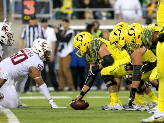 Oct 7, 2017; Eugene, OR, USA; Oregon Ducks offensive lineman Jake Hanson (55) readies the ball in the second half against the Washington State Cougars at Autzen Stadium. Mandatory Credit: Scott Olmos-USA TODAY Sports