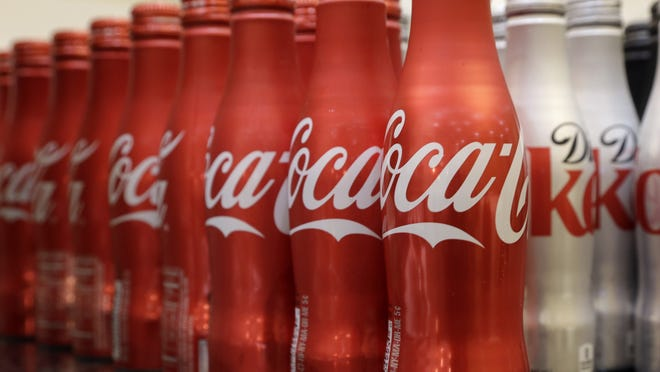 Coca-Cola is working with fitness and nutrition experts who suggest its soda as a treat at a time when the world's biggest beverage maker is being blamed for helping to fuel obesity rates.