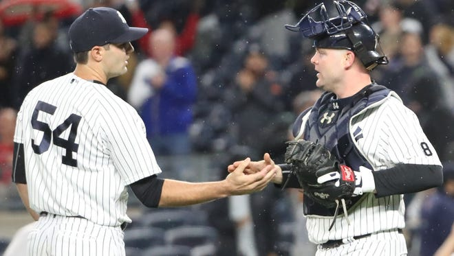 Sep 29, 2016; Bronx, NY, USA;  New York Yankees relief pitcher Richard Bleier (54) and catcher Brian McCann (34) celebrate after defeating the Boston Red Sox 5-1 at Yankee Stadium. Mandatory Credit: Anthony Gruppuso-USA TODAY Sports