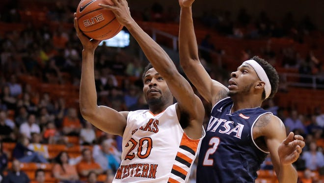 UTSA'a J.R. Harris, right, defends UTEP's Earvin Morris as he shoots Saturday, March, 5, 2016 at the Don Haskins Center in El Paso, Texas.