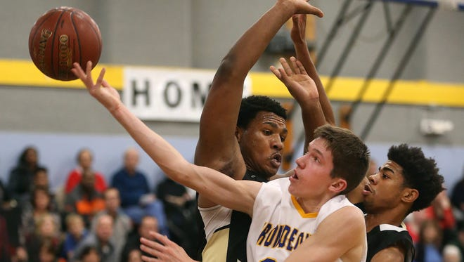 Irondequoit senior point guard Zach Stenglein, showing trying to score against Rush-Henrietta, leads the top-seeded Eagles into Saturday's 4 p.m. Section V Class A1 title game against No. 2 and rival Greece Athena.