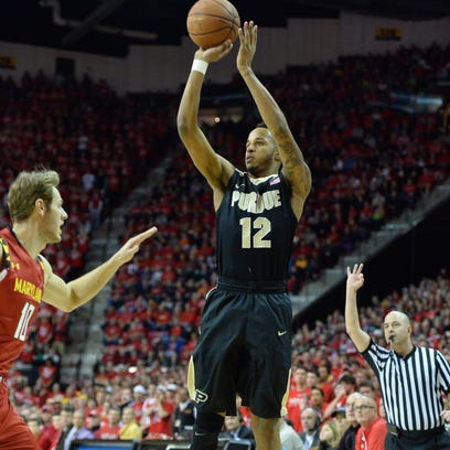 Purdue forward Vince Edwards (12) shoots a 3-point shot as Maryland forward Jake Layman (10) defends during the first half at Xfinity Center.