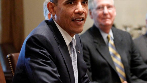 President Obama and Senate  Majority Leader Mitch McConnell,