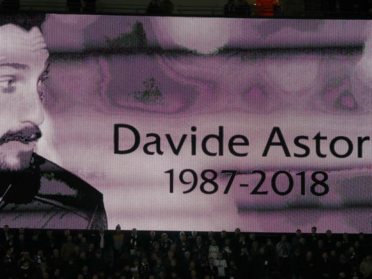 An image of Fiorentina captain Davide Astori is projected on a giant screen prior to the Champions League, round of 16, second-leg soccer match between Juventus and Tottenham Hotspur, at the Wembley Stadium in London, Wednesday, March 7, 2018. Fiorentina captain Davide Astori was found dead in his hotel room on Sunday at the age of 31 after a suspected cardiac arrest before an Italian league match. (AP Photo/Kirsty Wigglesworth)