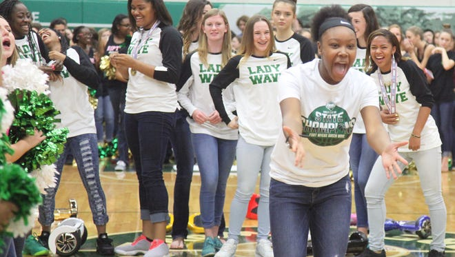 Fort Myers High School girls basketball team manager Alexis Henry, along with other members of the team, celebrate during a pep rally on Tuesday to honor the team for winning the Class 6A state title.