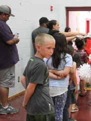 Loving Elementary students wait in line to receive