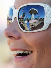 Jillian Nunes of Tulare watches her children Hope and Mickey swing during the Tulare County Fair in 2011.