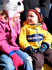 Abby Good, 10, left, looks at her brother Eli Good,