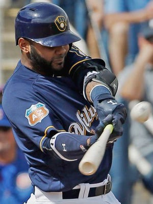 Milwaukee Brewers' Jonathan Villar hits a triple during the first inning of a spring training baseball game Thursday, March 3, 2016, in Phoenix.