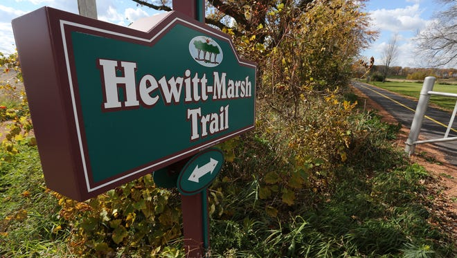 A colorful sign marks the Hewitt-Marsh Trail as it hits Staadt Road between Marshfield and Hewitt, Thursday, October 15, 2015.