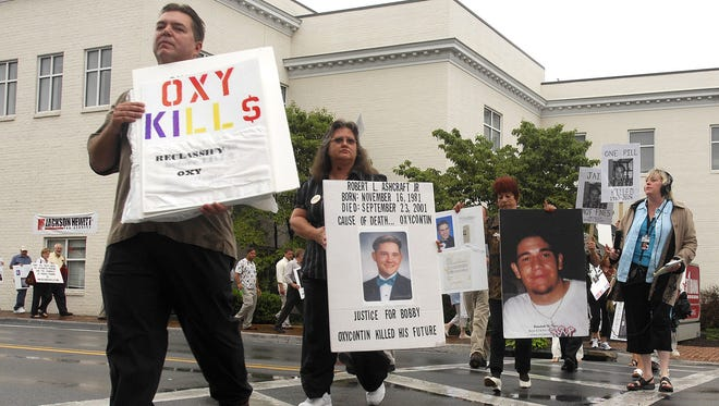 In this Friday, July 20, 2007, file photo, demonstrators march along Main Street in Abingdon, Va., to raise awareness about the abuse of OxyContin. From 2000 to 2016, prescription opioid abuse has claimed the lives of 165,000 Americans, according to federal estimates.
