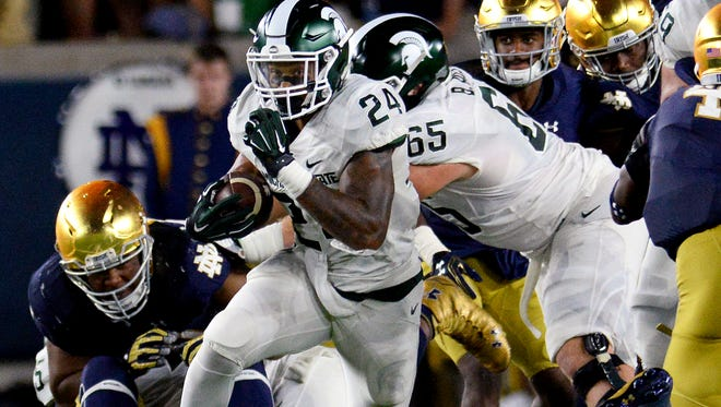 Michigan State University junior running back Gerald Holmes (24) bursts through the line on his way to a 73-yard touchdown in the second half of the Spartans 36-28 win over Notre Dame Saturday, Sept. 17, 2016 in South Bend, Ind.