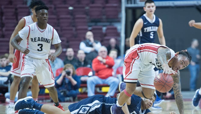 Larry Wingo, right, of Reading gets control of a loose ball after Chambersburg's Tyron Williams loses his footing. Chambersburg battled Reading for the PIAA D3 6A basketball title on Saturday, March 3, 2018. The Red Knights won 46-43.