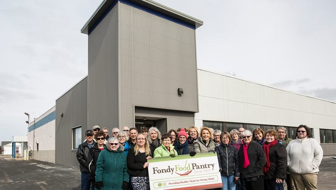 Fondy Food Pantry volunteers stand outside their new location Tuesday, March 20, 2018, at 573 W. Rolling Meadows Drive.
