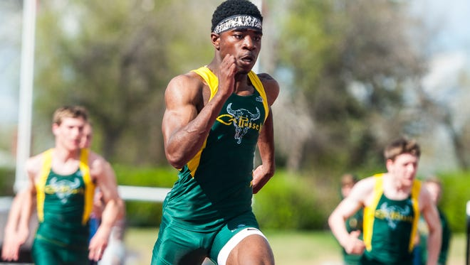 C.M. Russell's Damien Nelson won Eastern AA Divisional titles in the 100 and 200 this weekend in Butte.