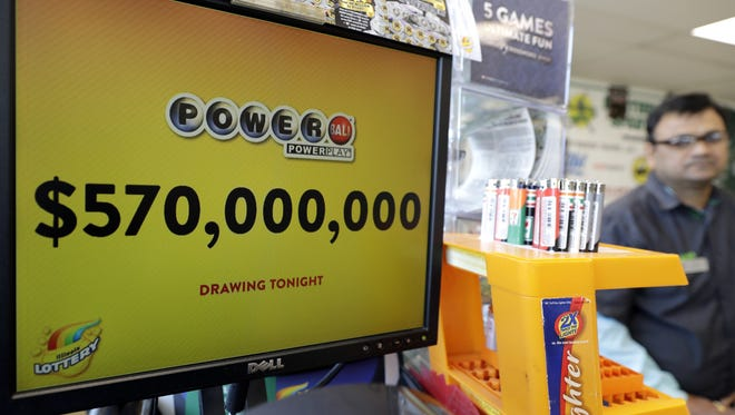 A Powerball lottery sign displays the lottery prizes at a convenience store Saturday, Jan. 6, 2018, in Chicago. The jackpot jumps to an estimated $570 million for Saturday's drawing. That would make it the nation's 8th largest lottery prize ever. (AP Photo/Nam Y. Huh)
