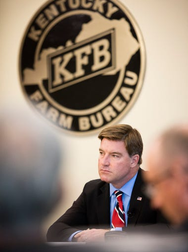 Democrat Jack Conway listens to a question during the