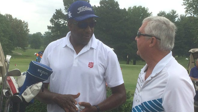 """Jack """"Goose"""" Givens, an All-American and member of the University of Kentucky's 1978 NCAA championship team, visits with Dennis Owens of Henderson before the Sam Ball Salvation Army golf scramble Monday at Henderson Country Club."""