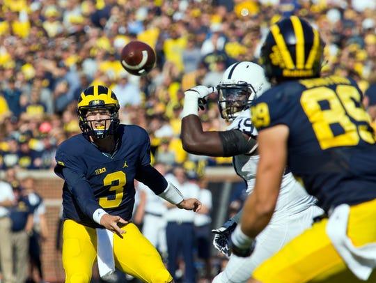 Michigan quarterback Wilton Speight (3) throws a pass